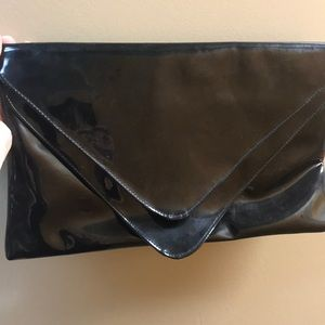 Large Black patent leather clutch.